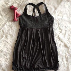 Black and grey Lululemon yoga tank with bra